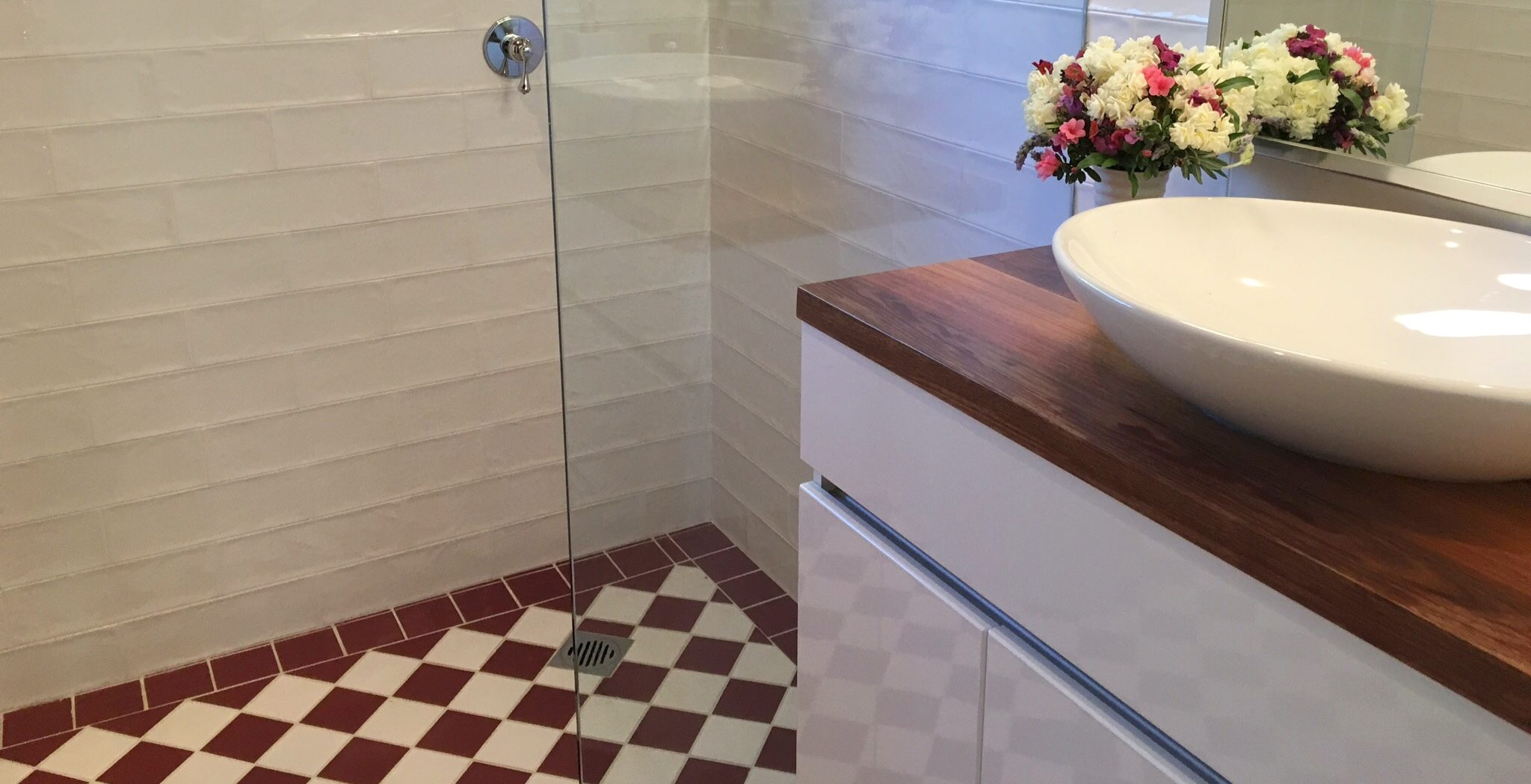 Stunning above counter bowl with timber top vanity with federation tiling. Bathroom renovation by Master Bathrooms & Kitchens
