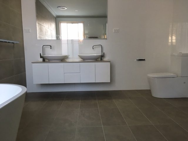 Back to wall close coupled toilet suite