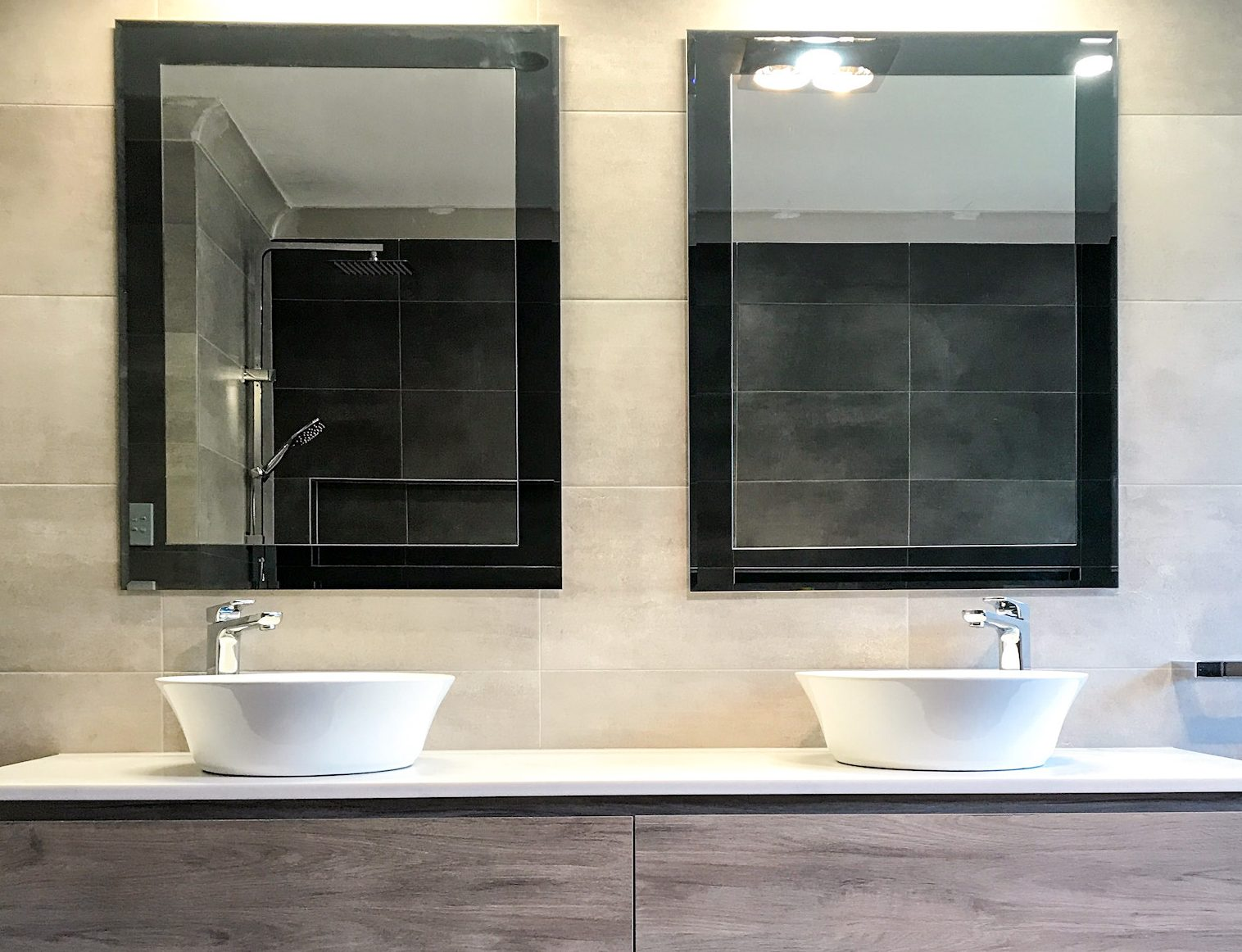 Double mirrors with double bowl vanity - bathroom renovation by Master Bathrooms & Kitchens.