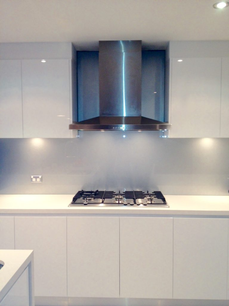 Gorgeous white with stainless steel - kitchen renovation by Master Bathrooms & Kitchens.