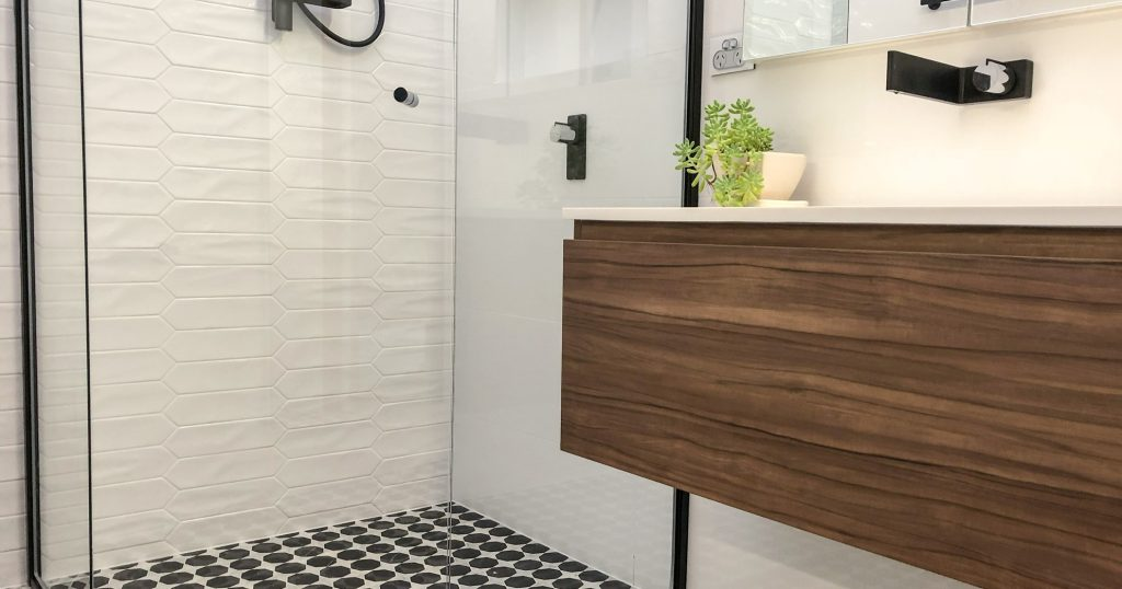 Gorgeous timber wall hung vanity with marble mosaic floor tile.