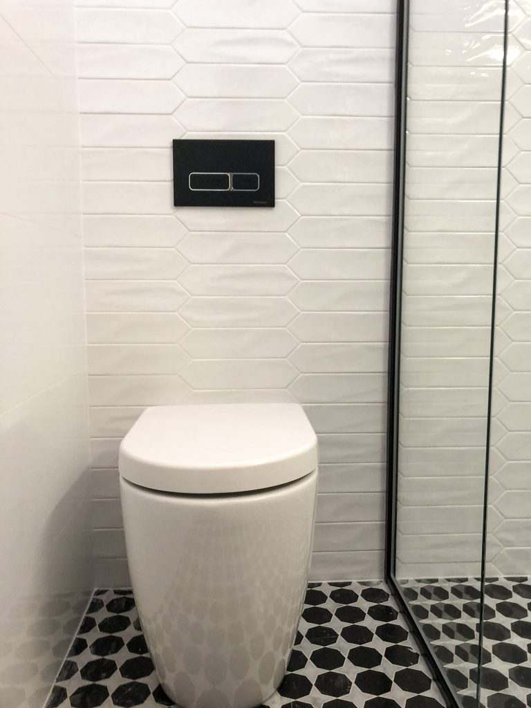 Rimless wall faced toilet with in-wall cistern creates a modern, seamless look and is easy to clean - bathroom renovation by Master Bathrooms & Kitchens.