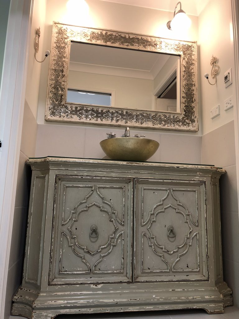 Stunning antique styled vanity - bathroom renovation by Master Bathrooms & Kitchens.