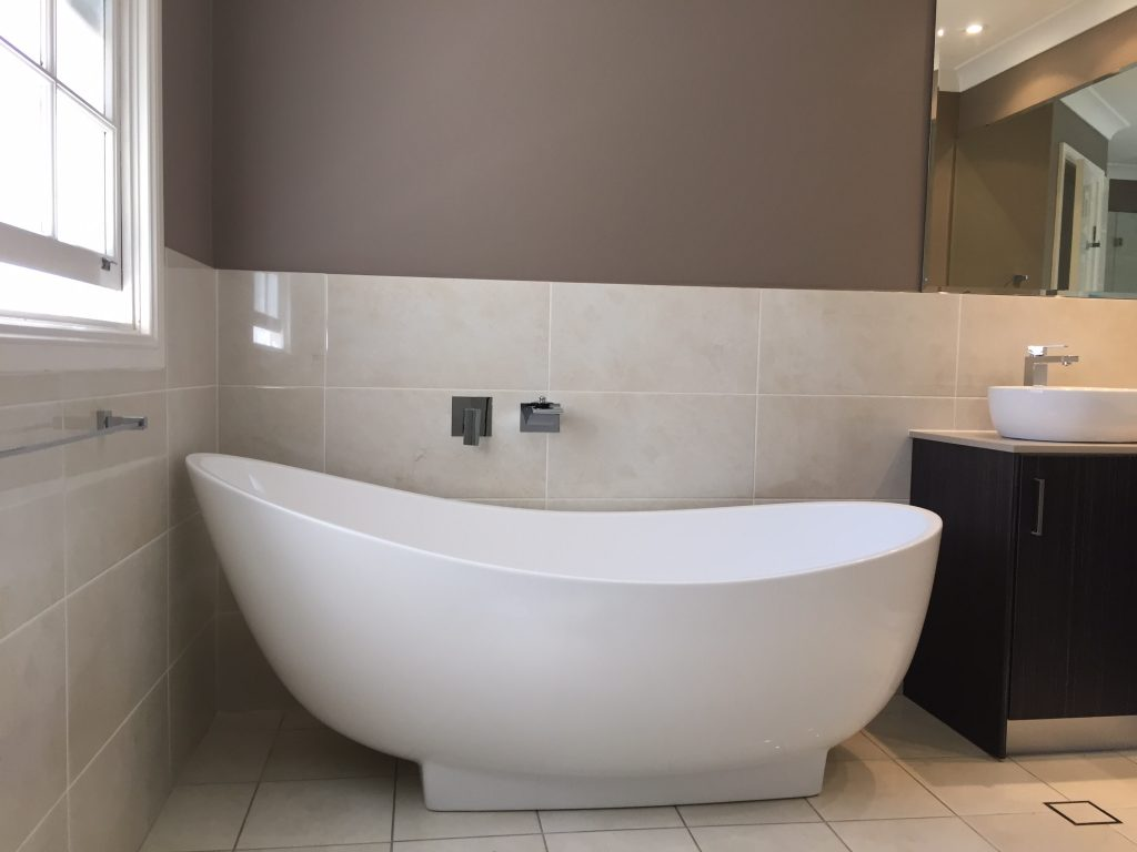 Walls tiled to 1200mm high with wall paint used as a feature - bathroom renovation by Master Bathrooms & Kitchens.