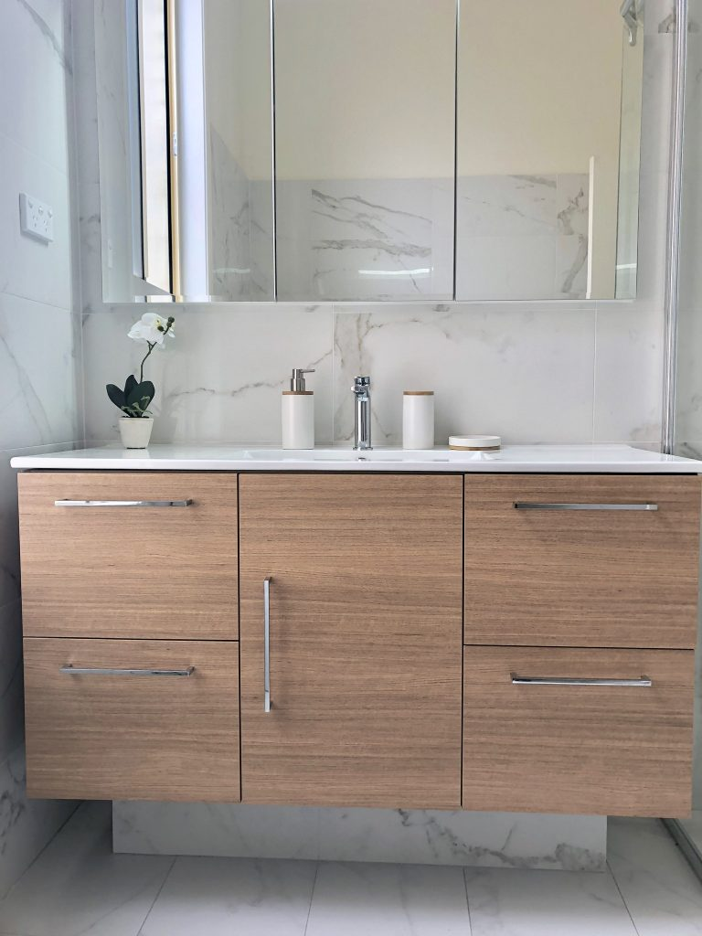 Gorgeous timber on veins. Floor standing vanity supported by a plinth - bathroom renovation by Master Bathrooms & Kitchens