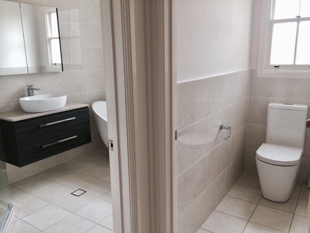 Family bathroom with separate toilet