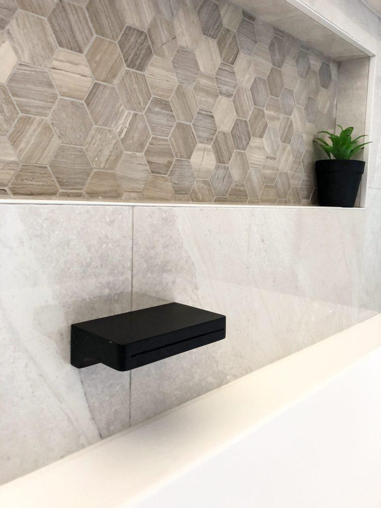 Stunning niche above free standing bath