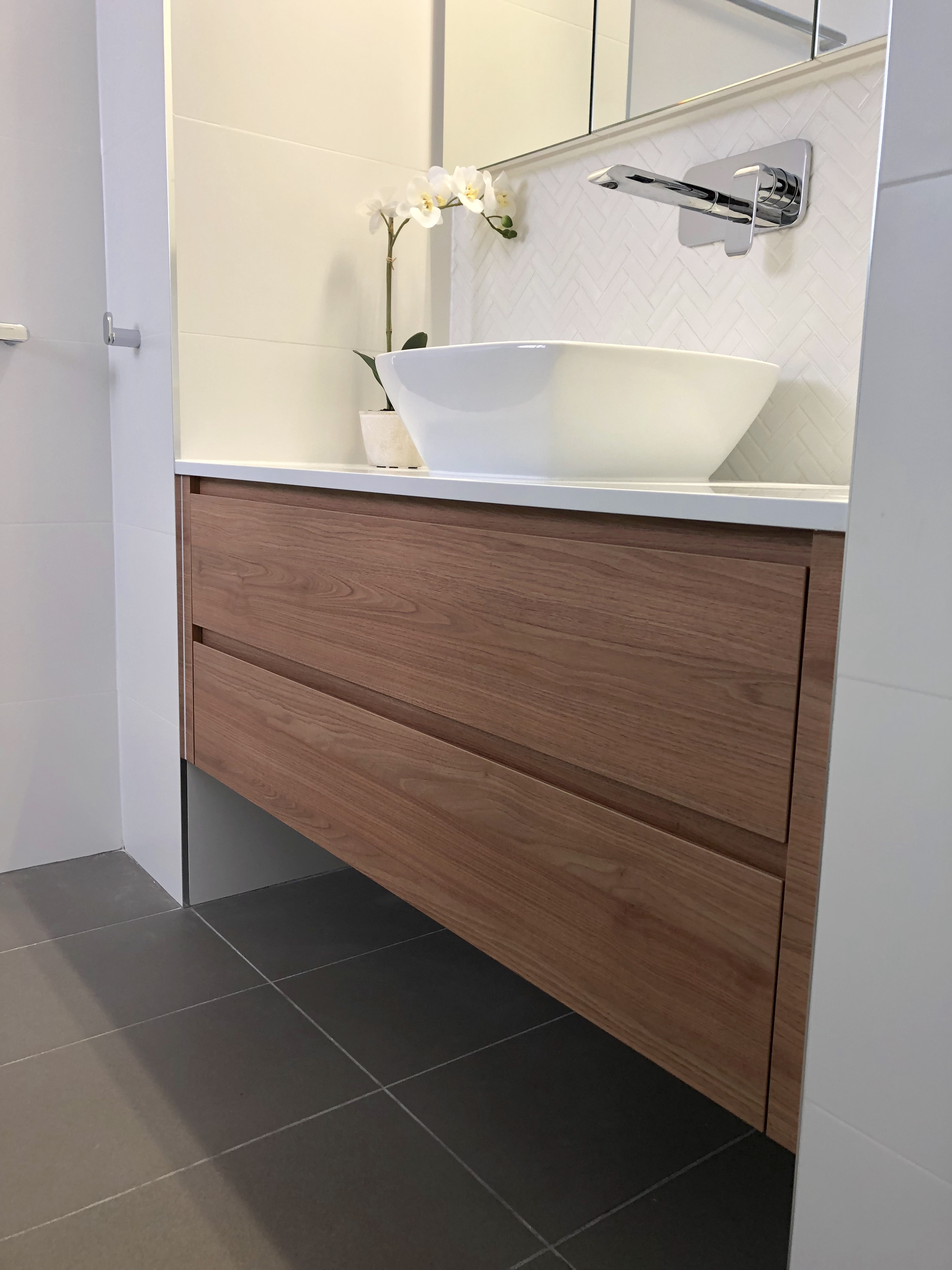 Gorgeous custom made vanity & shaving cabinet with wall mounted tap, above counter bowl & herringbone tile splashback - bathroom renovation by Master Bathrooms & Kitchens