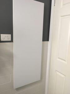 Hidden recess cupboard with white door