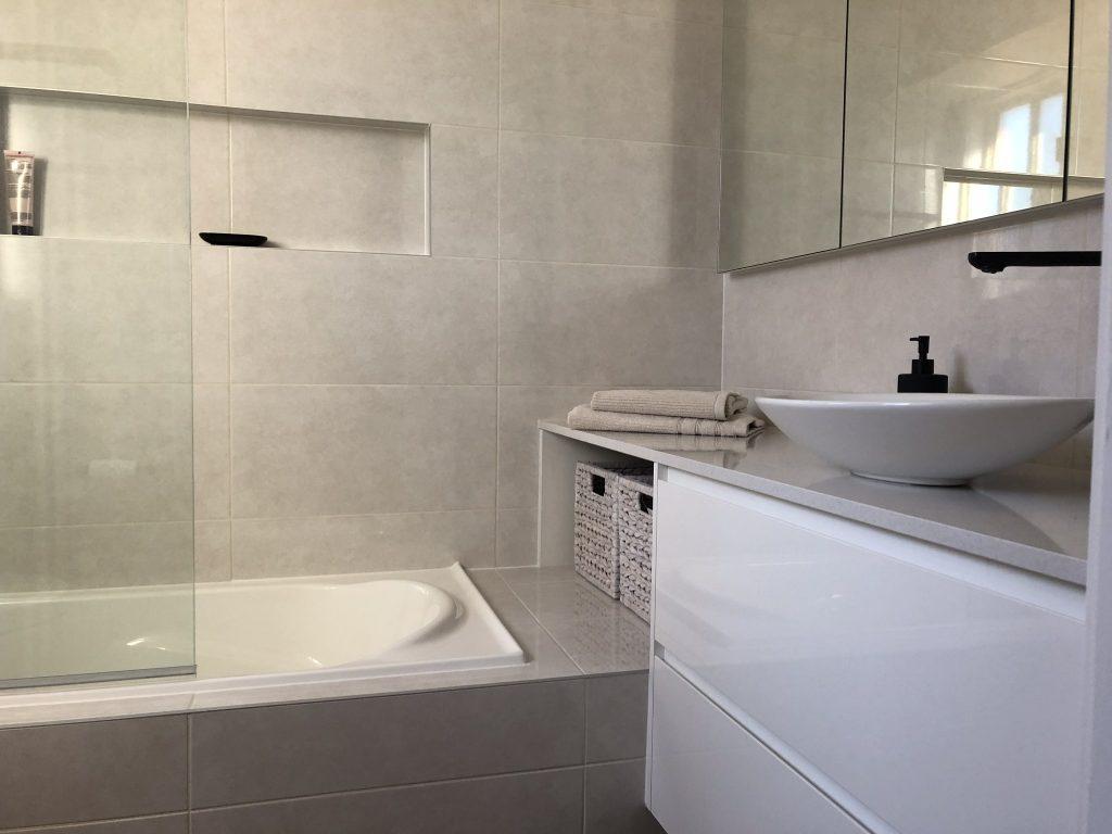 Stunning custom vanity with recess mirrored shaving cabinet