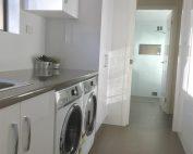 Stunnin laundry with adjoining bathroom
