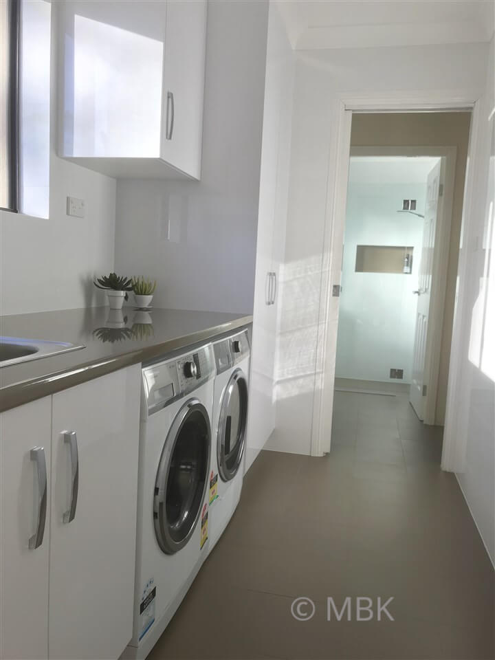 Stunning laundry with adjoining bathroom
