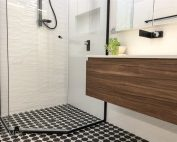 Marble mosaic feature floor, wall hung vanity with custom shaving cabinet and stunning modern, black tapware - bathroom renovation by Master Bathrooms & Kitchens.