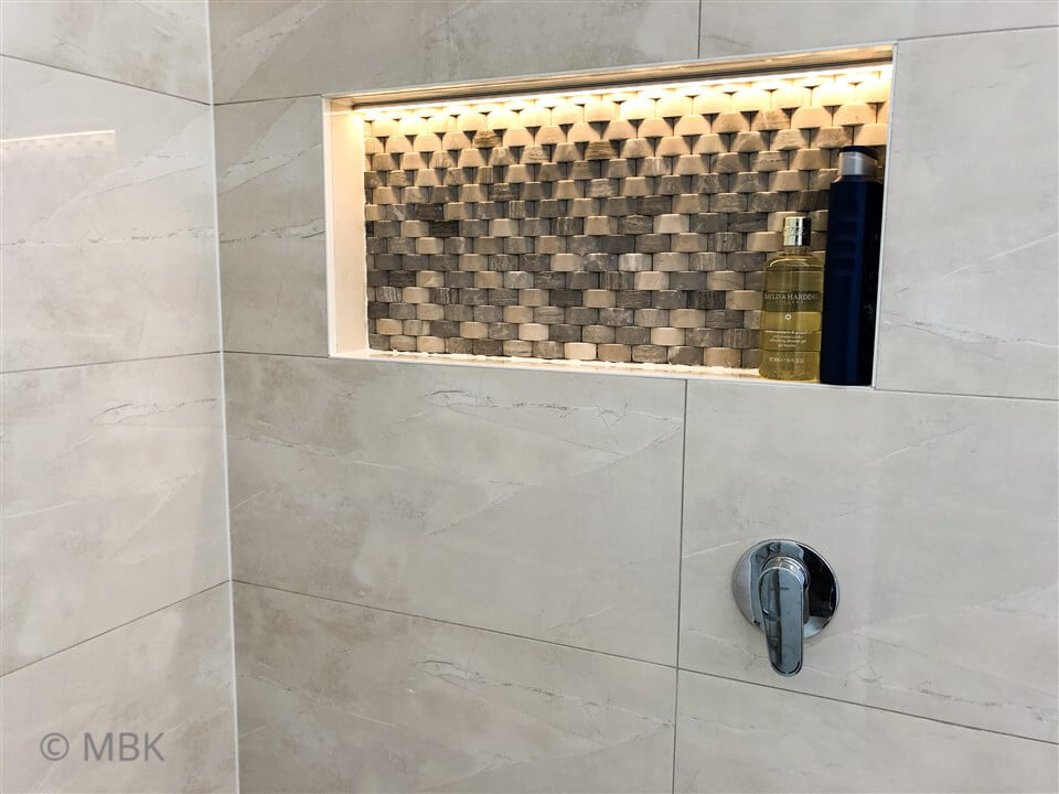 Gorgeous shower niche with feature tile and LED strip lighting - bathroom renovation by Master Bathrooms & Kitchens.