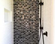 Beautiful black rainfall shower with adjustable hand held shower rose and shower niche. Bathroom Renovation by Master Bathrooms & Kitchens.