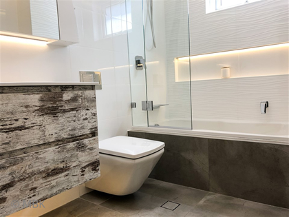 Undercabinet lighting & niche lighting - bathroom renovation by Master Bathrooms & Kitchens.