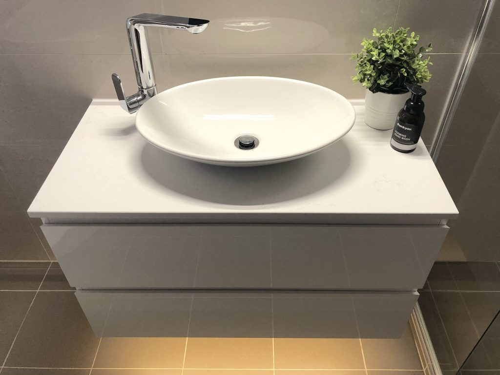 Gorgeous white wall hung vanity with deep drawers and above counter bowl