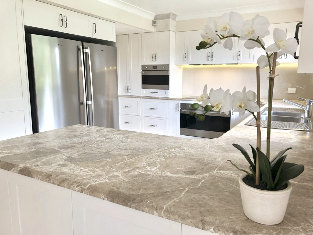 Beautiful natural marble benchtops with shaker cabinets - kitchen renovation by Master Bathrooms & Kitchens.