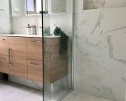Stunning marble look alike porcelain tiles - bathroom renovation by Master Bathrooms & Kitchens