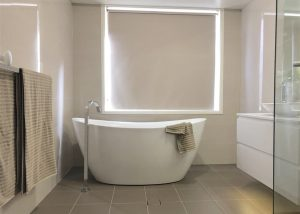 Stunning free standing bath with floor mounted bath filler - bathroom renovation by Master Bathrooms & Kitchens.