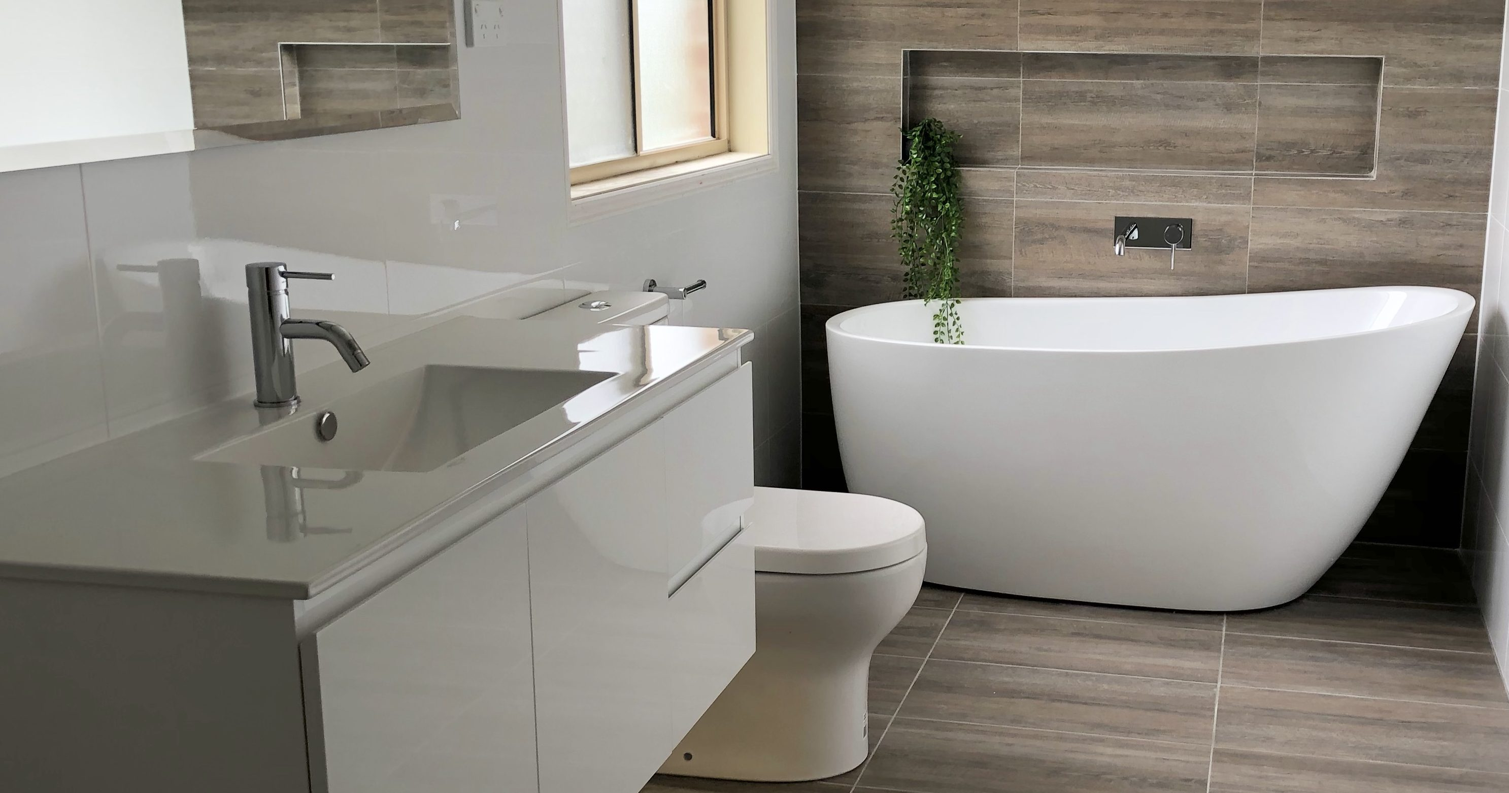 Stunnning freestanding bath, wall hung vanity and feature wall - bathroom renovation by Master Bathrooms & Kitchens