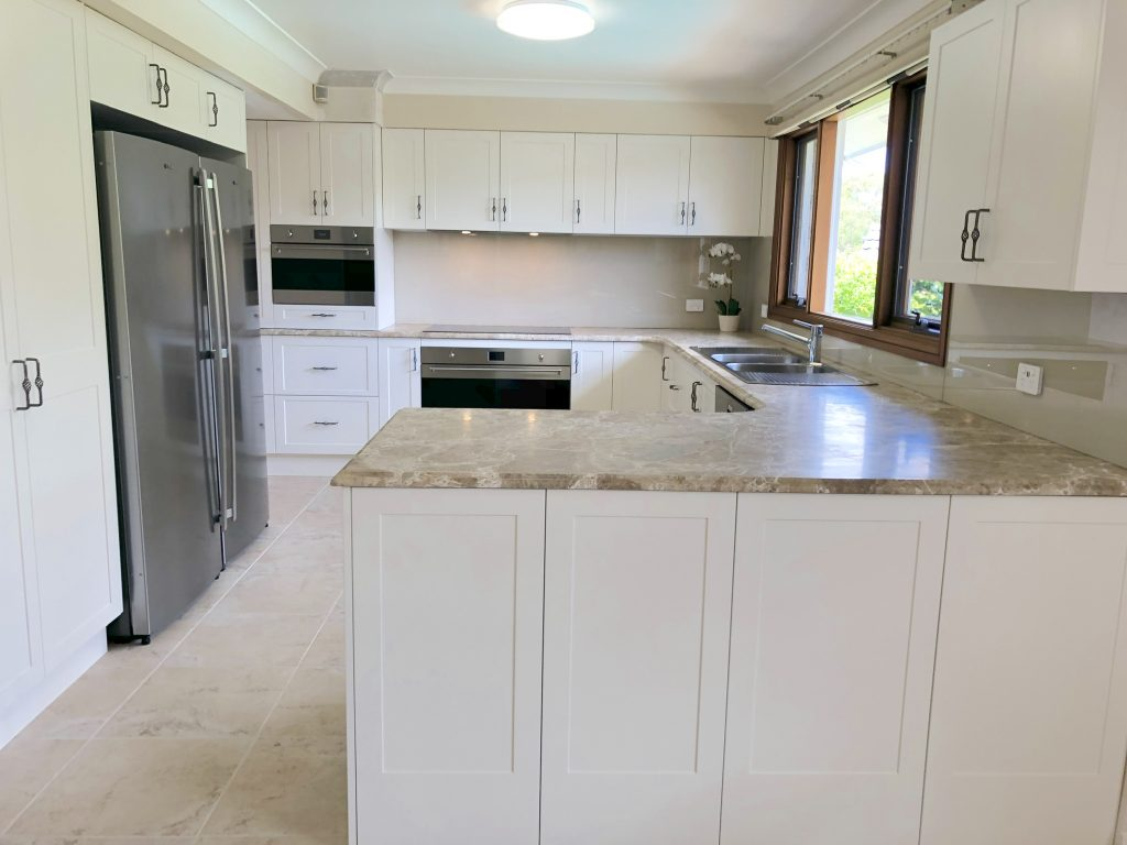 Timeless shaker cabinets with natural marble benchtops - kitchen renovation by Master Bathrooms & Kitchens