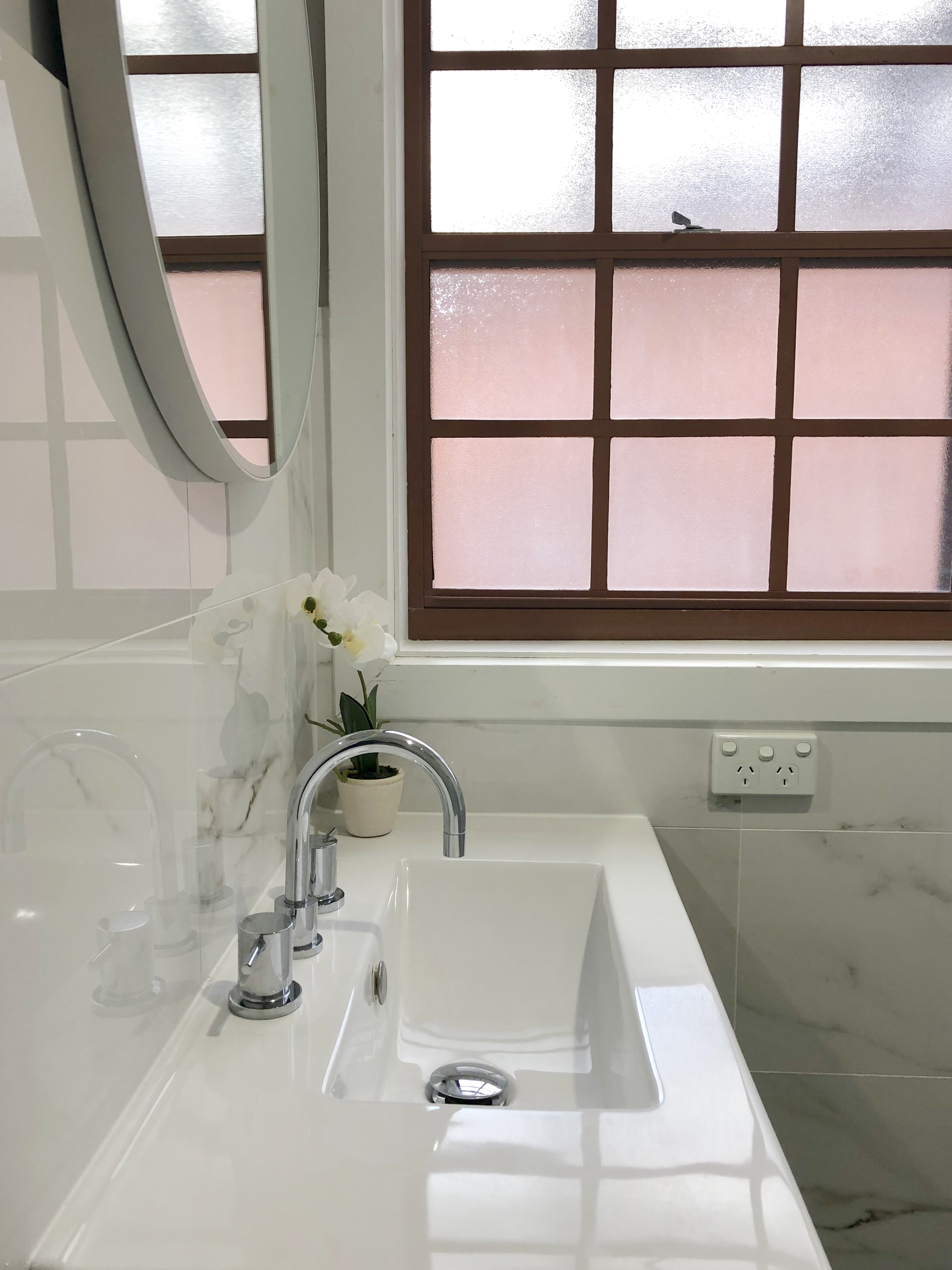 Natural elements blending perfectly - bathroom renovation by Master Bathrooms & Kitchens.