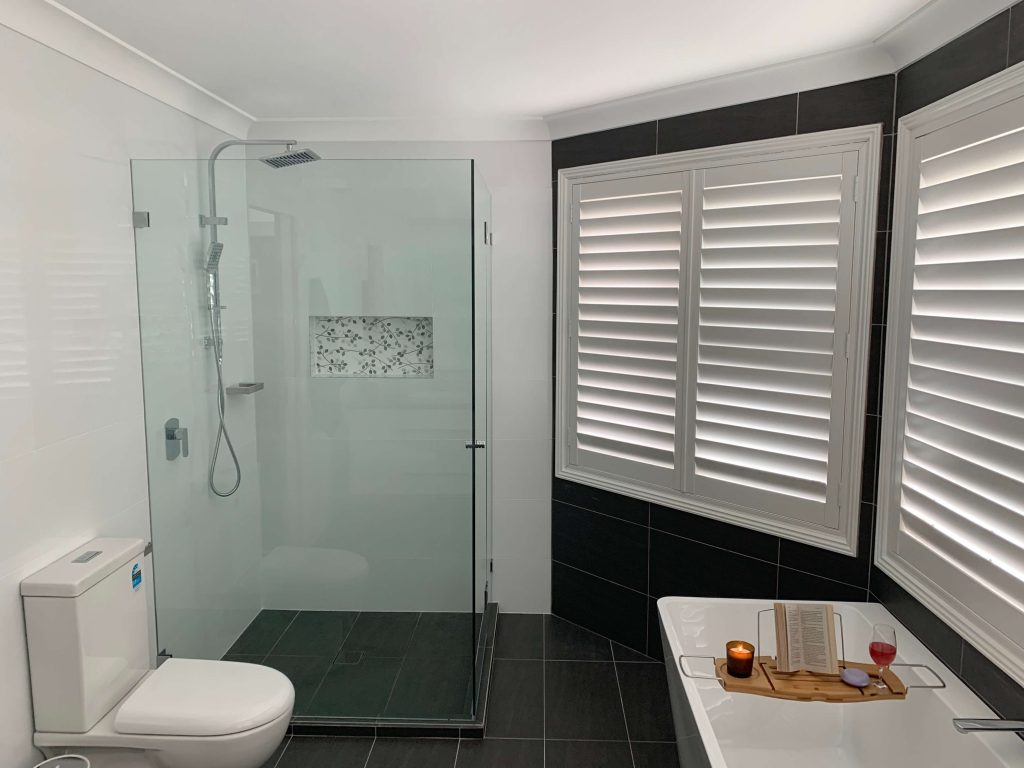 Beautiful shower recess with chrome rail shower, niche & frameless shower screen - bathroom renovation by Master Bathrooms & Kitchens.